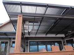 The American Louvered Roof Patio Cover is great for covering an outdoor space to protect patio from rain and sun.   It opens and closes with a handheld remote.
