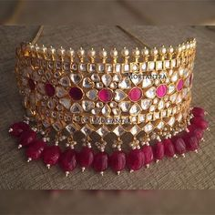 Our plum color set became a hit 😍 This beautiful color got in trend this year and was seen trending each charts in fashion. How could we hold it back ? The pretty pretty choker now available in plum shade 😍😍 Indian Jewelry Sets, Indian Wedding Jewelry, Royal Jewelry, India Jewelry, Gold Jewellery, Jewellery Designs, Indian Bridal, Bridal Jewellery Inspiration, Rajputi Jewellery