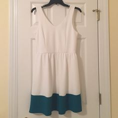 White Willy Jay's Dress White dress from Willy Jay's w green/teal stripe at the bottom. Size L, barely worn. Just in time for Easter ladies :)) Willy Jay's  Dresses