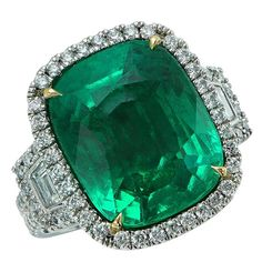 Stunning 11.75 Carat Colombian Emerald Engagement Ring | From a unique collection of vintage engagement rings at https://www.1stdibs.com/jewelry/rings/engagement-rings/