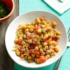 Coconut-Ginger Chickpeas & Tomatoes Recipe -This is my go-to quick dish. When you add tomatoes, you can also toss in some chopped green peppers (jalapenos, if you like heat) to make it even more colorful. —Mala Udayamurthy, San Jose, California