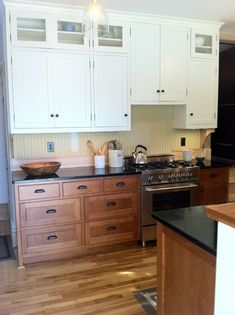 Just the wood and white cabinets! stained lower cabinets ...