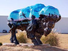 "Buffalo Stampede painted buffalo. - ""Vincit"" Sponsor: Wal-Mart Food Distribution Center Artist: Jeff Prescott Located at Wal-Mart Food Distribution Center, Ocheleta"