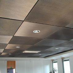 drop ceiling tiles painted with metallic aluminum paint. paint tiles covered with a thin metal mesh