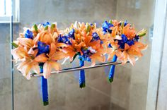 The bridesmaids bouquet were made with orange asiatic lilies and blue delphinium.
