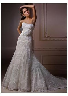 Strapless lace dress with a bow adorning the waist and a chapel train-Inspire tenderness, beauty and happiness with your wedding dress, we make it possible at Www.DreamDress.co/custom.