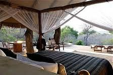 Kiba Point Selous is a private safari lodge of just four open-fronted rooms on the Rufiji River in Tanzania's wild Selous Game Reserve. Safari Chic, Colonial, Safari Bedroom, Private Safari, Safari Decorations, House On The Rock, Interior Decorating, Interior Design, Game Reserve