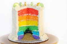 Sweets: Magically Delicious Rainbow Cake with gold sprinkles inside, perfect for St. Patrick's Day or rainbow borthday parties