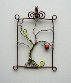 """Inspiration: """"Eden"""". From Artist Louise Goodchild on Etsy here (her website also has lots of wire work projects here).Craft wire and a red miracle bead. Love the serpant in acid green. Not tree of life, I know, but similar."""