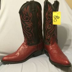 NWT Old West Black/Red Ostrich Print Cowboy Boots NWT. Has the alligator print toes. 8.5 Men 10 Women. There is a bit of scuffing on the heel (see picture) from moving around in the closet. No box but will make sure packaged properly. Bought from a Lone Star Outlet so price was $65 but this boot is worth about $120. I have never worn. Shoes