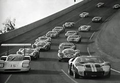 Pace lap for the 1967 Daytona 24 Hour race.  Notice the different style cars.  Today they all look the same.