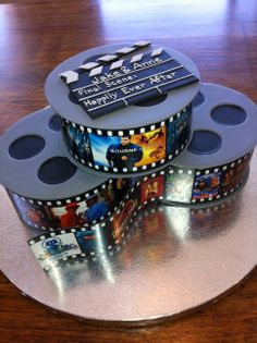 Jake's Cake - Film reels for a real-movie buff.  Gumpaste disks sandwich a single layer of fondant covered cake.  The 'film' was printed at the copy shop on glossy paper --not edible.