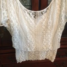 Feminine white lace Peasant Top. Beautiful lace over an attached tank top. Elastic waistline for a slimming fit! Perfect for summer shorts , capris, skirts or jeans. Tops