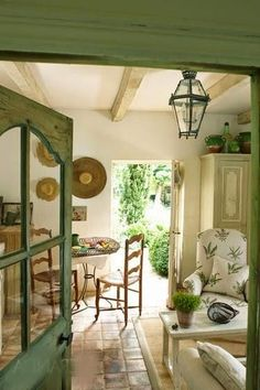 green accents throughout? to tie in with exterior? large terra cotta tiles for kitchen flooring