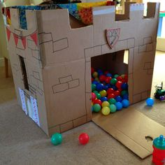 cardboard castle, have the kids decorate with markers, stickers, and then take photos with it