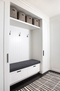 Charming mudroom designed with black and white in mind! This space features white plank walls over a black cushion mudroom bench with two white drawers flanked by white shaker built in cabinet doors. Home Entrance Decor, House Entrance, Entryway Ideas, Entryway Storage, White Plank Walls, Mudroom Laundry Room, Bench Mudroom, Wall Bench, Entry Closet
