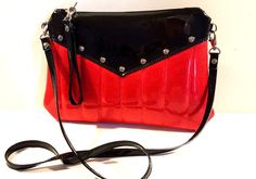 ALL ITEMS ARE MADE TO ORDER. PLEASE ALLOW 2-3 WEEKS FOR PRODUCTION AND DELIVERY. RUBY RED SPARKLE CROSSBODY BAG WITH YOUR CHOICE OF VINYL TRIM & LINING! *Trim = top yoke and straps  A new addition to the Hold Fast tufted line, this retro-style crossbody is nice and roomy for the gals that just need to carry more. Fiery ruby red sparkle vinyl is paired with your choice of vinyl trim (shown here with Black Gloss), make it as flashy or classy as you wish.  A lower body with tufted topst...