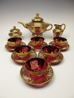 Cranberry glass tea set with gilded and raised enamelled decoration. £595.00, via Etsy.