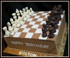 "Chess cake - 12"" square cake to look like chessboard. Chess pieces are chocolate."