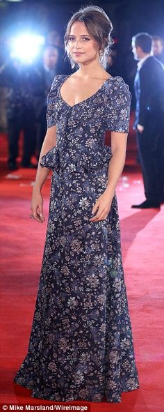 Belle of the ball: Alicia went for a subtle yet seasonally chic approach to red carpet glam, dinning a low-cut, floor-length floral gown for the evening