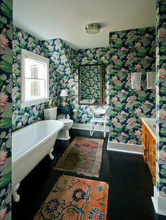 Blue and green lily pad printed wallpaper in the a bathroom