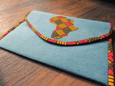 So after much debate, I tallied up the votes and more of my lovely followers thought I should add the african symbol to this #africaninspired clutch. So I did. I just made it a little bigger because that small one wasn't hitting for me at all.   Now I'm so in love with this bag!! Her name is Sadiki.  #motherafrica #afrocentric #kitenge #ankara #ankarafashion #ankarastyle #blackandproud #africanaccessories #clutches #handbags #africanhandbags #handcrafted #fistsup #ethnic