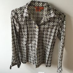 Tory Burch geometric print button down Tory Burch geometric button down size 4. Brown and blue one button missing you can take from collar great for under a sweater Tory Burch Tops Button Down Shirts