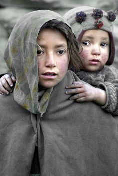 People, who live at an altitude of 3000m in Hushe valley, northern Pakistan, pictured on Friday, 13 May 2005. Women work the fields and 95 per cent of men work as porters or cooks during the tourist trekking summer. Every year mountaineers flock to the valley to follow the famous routes, penetrating the world's so-called 'third pole', bordering India. Military skirmishes along this border have resulted in the closure of the route to Ladakh over the Siachen glacier.  EPA/OLIVIER MATTHY...
