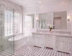 Elegant bathroom design with carrara marble inlaid tiled floor and brick cut bathroom marble wall tiles.