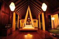 photo of bed in villa room with lights in Villa Inle Resort & Spa