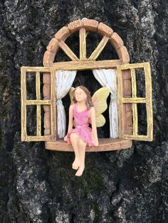 This fairy window will hang on your tree or stump. Measures approximately 4.75 inches tall and 4 inches wide. http://www.burgeandcompany.com
