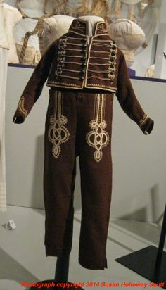 """1800-1830 Skeleton Suit - """"[This] wool skeleton suit was worn by John Worthington Williams, Sr., of Wethersfield, CT. For an American boy, the suit represents the elaborate military uniforms being worn by European officers in the Napoleonic Wars"""