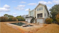 2701 Bayonne St, Sullivans Island, SC 29482 - Amenities: Elevators, Sec. Grd/sys, Cable Available Remarks: This front beach Sullivan's Island home is truly unique! From its stunning entrance to the soaring, panoramic windows of the great room, the meticulous design and construction create...