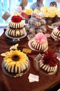 These are bought bundt cakes but you could make them yourself and freeze them ahead then decorate the day of the wedding.
