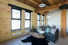 The PACIFIC at District Condos - Loft style conversion condos featuring exposed brick, century old wood beams, 14 ft ceilings and modern finishes. Great floor plan with lots of windows and space