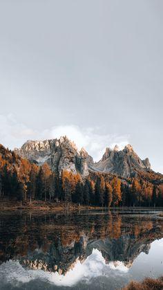Download premium image of Dolomites lake in autumn mobile phone wallpaper