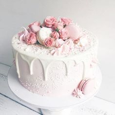 Hello beautiful! .... my kind of cake!  Pink perfection! By @lavender_bakery Super cute! #dripcake #cake #prettycake #pastels #pinks #cakeart #roses #macaroons #cakeart
