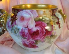 Magnificent French Piece. Limoges Lion Heads Jardiniere with beautiful hand painted roses.