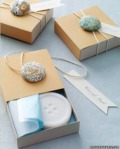 too cute, blue buttons tied on top of a button soap favor.
