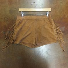 Love Richie Faux Suede Tassel Shorts Bohemian and summery! These camel colored tassel shorts are perfect for this season of concerts, picnics, etc. Pairs well with a peasant top. Zippers in the back. Never worn.                                                                                                   Save on shipping when you bundle!                                      30% off bundles of 2 or more!                                                        ▪️ No trades or PayPal please…