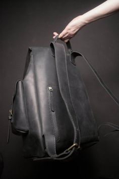 Leather mens backpack. Incredible backpack for real men incredibly large size and large volume! It has two side pockets with a hidden pocket in each. There is also pocket for laptop on the inside and a zippered pocket on the back. The size of a backpack regulated by straps with screws.  M
