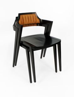 """A stackable modern design armchair by Victoria & Son, with arms pulled forward and a cantilevered back with ribbed leather upholstery and brass nail-head trim detail. Custom finishes and upholstery available.   Overall dimensions: 21.5""""deep x 19.5""""wide x 29""""high  Model R813"""