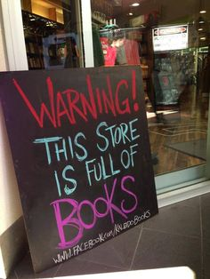 """<b><a href=""""http://go.redirectingat.com?id=74679X1524629&sref=https%3A%2F%2Fwww.buzzfeed.com%2Faaronc13%2F13-clever-signs-that-will-make-you-want-to-buy-a-book&url=https%3A%2F%2Fwww.facebook.com%2FKaleidoBooks&xcust=2768500%7CBFLITE&xs=1"""" target=""""_blank"""">Kaleido Books</a> in Perth, Australia really makes an art out of shop signage.</b>"""
