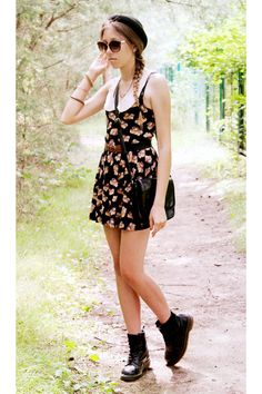 I've been told that boots with dresses are hipster...I wouldn't have believed it but this girl rocks the look.