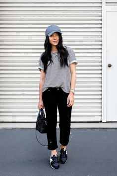 Striped loose short sleeve sweatshirt (tucked in), destroyed black jeans, black sneakers, gray baseball cap
