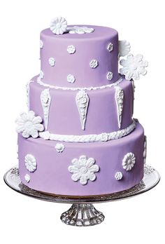Brides.com: 34 Stunning Wedding Cakes for a Winter Wedding. A Purple Wedding Cake With White Decorations. Purple-colored wedding cakes are appropriate for any season, but we like how this one has designs that recall icicles and snowflakes. This Michelle Doll Cakes creation also has whimsical white piping that adds a playful feel for a wedding.  See more purple wedding cakes.
