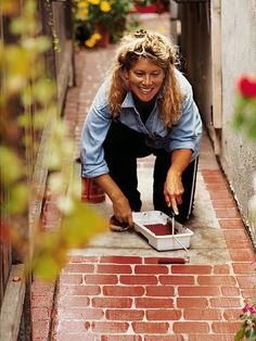 Great camouflage for an ugly cement path. Neato! – Some paint and a mini roller (and a steady hand) are all you need to turn boring concrete sidewalks into inviting brick pathways. – she did a 100 ft walkway and then liked it so much she painted her whole driveway. Cool!