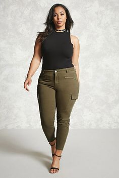 Forever 21+ - A pair of denim pants featuring side cargo pockets, front zip pockets, a mid-rise, and a zip fly front.