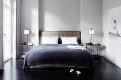 grey and blue colours in relaxing / elegant bedroom created by Oliver Jungel