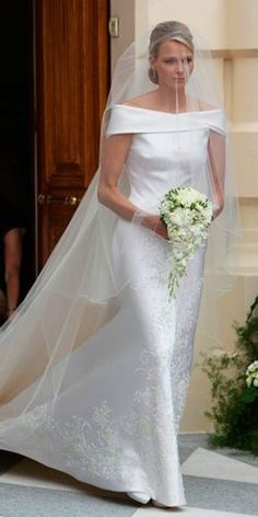 Princess Charlene of Monaco wore a wedding dress she described as 'Armani's masterpiece' for her wedding to Prince Albert. The dress reportedly took three seamstresses hours to make, and featured Swarovski crystals. Royal Wedding Gowns, Celebrity Wedding Dresses, Princess Wedding Dresses, Royal Weddings, Celebrity Weddings, Bridal Gowns, Dress Wedding, Wedding Hair, Fürstin Charlene